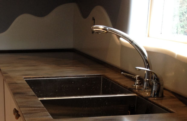 Durable solid surface backsplashes instead of tiles.