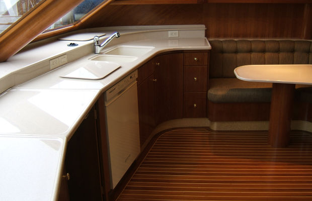 Complete and partial high impact solid surface custom interiors for boats and marine heads.