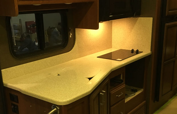 Durable solid surfaces with utility for recreation vehicles.